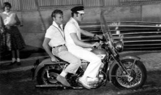 When I was in Memphis in 1987, I bought a copy of this photo in a gift store. I had never seen it before and the homoerotic factor hit home a while later in a Georgia Straight newspaper interview, Jerry lee Lewis - at the time of the Dennis Quaid bio-flick, talked about him and Elvis riding bikes nude and that if anyone knew then what they had gotten up to - both of their careers would have been over.