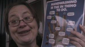 Nina with Handwashing poster