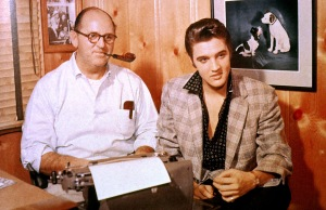 Colonel Tom Parker and Elvis Presley in October 1955 signing a record contract with RCA Victor. *** USA ONLY *** © Glenn A. Baker / Redferns / Retna Ltd.