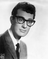 circa 1958:  Headshot of American rock 'n' roll musician and singer Buddy Holly (1936 - 1959) wearing his signature horn-rimmed eyeglasses.  (Photo by Hulton Archive/Getty Images)