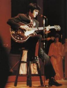elvis_playing_guitar_1969