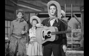 THE STEVE ALLEN SHOW -- Aired July 1, 1956 -- Episode 2 -- Pictured: (l-r) Andy Griffith, Imogene Coca, and Elvis Presley perform a parody of Country & Western television shows  (Photo by NBC/NBCU Photo Bank via Getty Images)