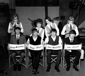 "The Beatles, George Harrison, Ringo Starr, Paul McCartney and John Lennon, have their hair combed by stylists on the set of their first movie production, ""A Hard Day's Night,"" at Twickenham Film Studios in Middlesex, outside London, England, on March 12, 1964. The hair stylists, who have parts in the film, are, from left, Patti Boyd, 19, Tina Williams, 17, Pru Bury, 22, and Susan Whitman, 17."
