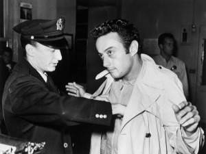 October 4, 1961 - San Francisco, CA. Lenny Bruce being booked  by the San Francisco Police after his arrest for obscenity at the Jazz Workshop.