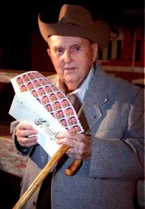 Col Tom Parker was the first to receive Elvis stamps during a first day the stamps went on sale at the Las Vegas Hilton on 1-8-93. jeff scheid