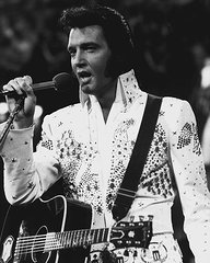 elvis-presley-holds-the-microphone-while-singing-retro-images-archive