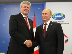 Prime Minister Stephen Harper shakes hands with Russian President Vladimir Putin during the APEC summit in Vladivostok, Russia, Saturday Sept 8, 2012. THE CANADIAN PRESS/Adrian Wyld