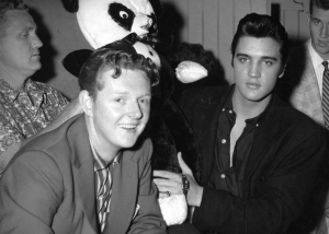 MANDATORY PHOTO CREDIT:  Collection of Red Robinson  Vancouver, Aug. 16, 2007  Elvis Presley with Vancouver disc jockey Red Robinson before his concert at Empire Stadium on Aug. 31, 1957.   With John Mackie story.   [PNG Merlin Archive]  MAKING HEADLINES