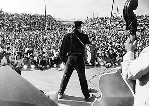 Elvis002.jpg...A screaming crowd of thousands of teenagers welcomed a guitar-thumping Elvis Presley back to the town where he was born, Tupelo, Miss. Staff photo by Eldred Reaney (The Tennessean) 8/26/1956