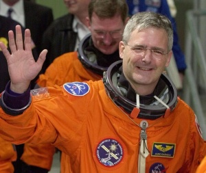 Mission specialist Marc Garneau of Canada waves to photographers as he leaves the Operations and Checkout Building on Nov. 30, 2000. A senior federal minister warmly thanked Liberal MP Marc Garneau for helping to get the Canadarm displayed in a national museum — just three weeks before Garneau was snubbed at the official unveiling. THE CANADIAN PRESS/AP,Chris O'Meara