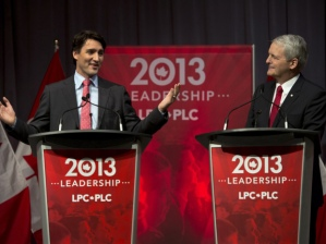 Justin Trudeau, left, and Marc Garneau exchange views at the Liberal party leadership debate in Halifax on Sunday, March 3, 2013. THE CANADIAN PRESS/Andrew Vaughan