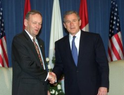 Canadian Prime Minister Jean Chretien, left, greets President George W. Bush during their meeting in Quebec City, Canada, Friday, April 20, 2001. (AP Photo/Rick Bowmer)