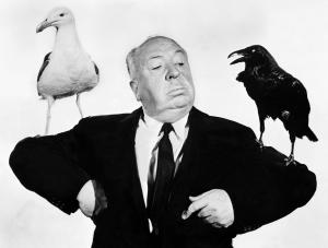 ORG XMIT: S11ABC5EB_WIRE (FILES) File picture taken in 1963 shows British film director Alfred Hitchcock (1899-1980) during the shooting of his movie 'The Birds'. Hitckcock directed his first film in 1925 and rose to become the master of suspense, internationally recognized for his intricate plots and novel camera technique. Hollywood will celebrate 13 August 1999 the centenary of Hitchcock's birth. AFP PHOTO FILES IMF25 09102004xMOVIES 10072005xGuidelive