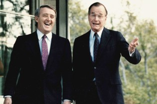 WASHINGTON, DC - APRIL 28: This file photo taken 28 April 1988, shows former US Vice President George Bush (R) as he shares a laugh with Canada's former Prime Minister Brian Mulroney, following a question from a reporter outside Bush's residence in Washington, DC. Mulroney was scheduled to have a second meeting with former US President Ronald Reagan later in the day. AFP PHOTO Mike SPRAGUE (Photo credit should read MIKE SPRAGUE/AFP/Getty Images) ORG XMIT: POS1211221818313466