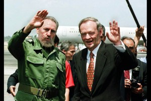 Canadian Prime Minister Jean Chretien(R) and Cuban leader Fidel Castro(L) wave to reporters 28 April at Havana's Jose Marti Airport during a farewell ceremony for Chretien who returned to Canada following a three-day official visit to Cuba. Chretien called for the release of four prisoners detained without trial.  AFP PHOTO/Adalberto ROQUE