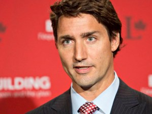 Liberal Leader Justin Trudeau speaks to media during a break at the federal Liberal summer caucus meeting in Edmonton on Tuesday, Aug. 19, 2014. THE CANADIAN PRESS/Jason Franson
