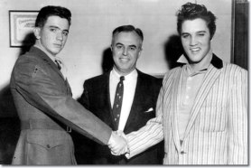 1957_march_26_pfc_hershel_nixon_shake_hands