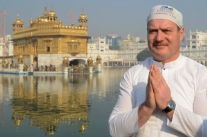 Politician from British Colombia, Canada, Michael de Jong pays his respects at the Sikh Shrine Golden Temple in Amritsar on December 3, 2012.  Jong, along with officials, visited the city to pay his respects at the Sikh Shrine.    AFP PHOTO/NARINDER NANUNARINDER NANU/AFP/Getty Images