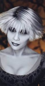 Chiana, from the TV show Farscape, has a mouth like a sailor. But she usually talks about frelling tralks and pieces of drenn, so it's okay.