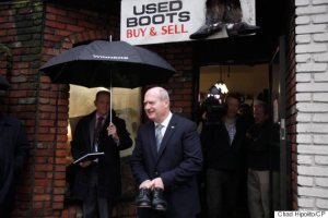B.C. Finance Minister Michael de Jong leaves Olde Town Shoe Repair after picking up his Budget 2016 dress shoes at Olde Town Shoe Repair in Victoria, B.C., Monday February 15, 2016. THE CANADIAN PRESS/Chad Hipolito
